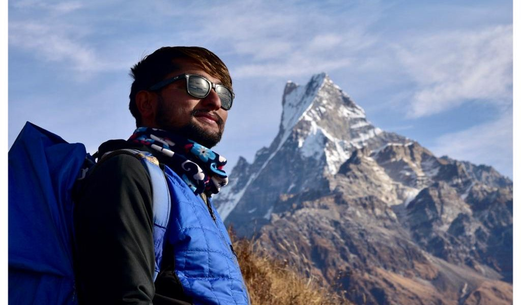 Director of heaven Himalaya, Ramhari Adhikari posing for a photo inform of mountain Fishtail in the Mardi Himal Trek