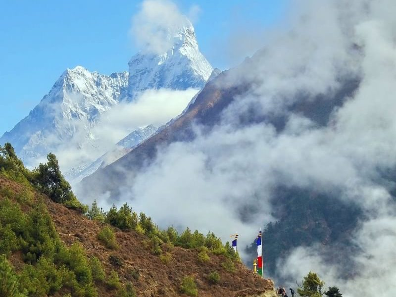 Mount Amadabalm peeking through the clouds captured during everest view trek