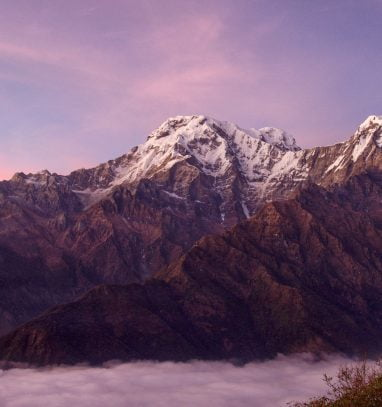 The mountains looks like floating in clouds captured during Mardi Himal Base Camp Trek