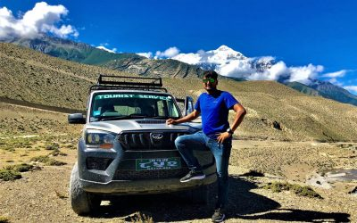 A man standing in front of a jeep that goes to Upper Mustang (Upper Mustang Jeep Tour)