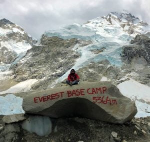 A woman posing for a photograph at Everest Base Camp - Trekking in Nepal