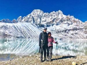 A couple in front of Gokyo Lake in Everest Region - Best Treks in Nepal for 2021