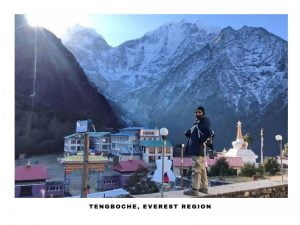 a girl posing for aa photograph at tengboche