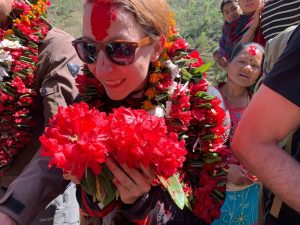 Michelle being welcomed by flower garlands